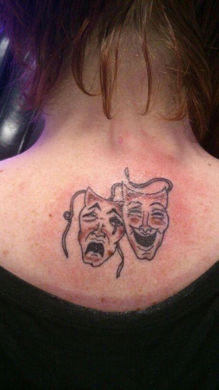 Theatre masks, upper back bone. Mine :-)