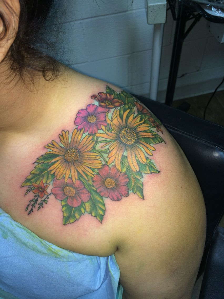 Colorful flower shoulder cap tattoo done by ricky garza