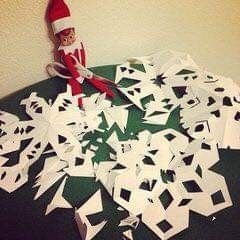 Elf makes snowflakes