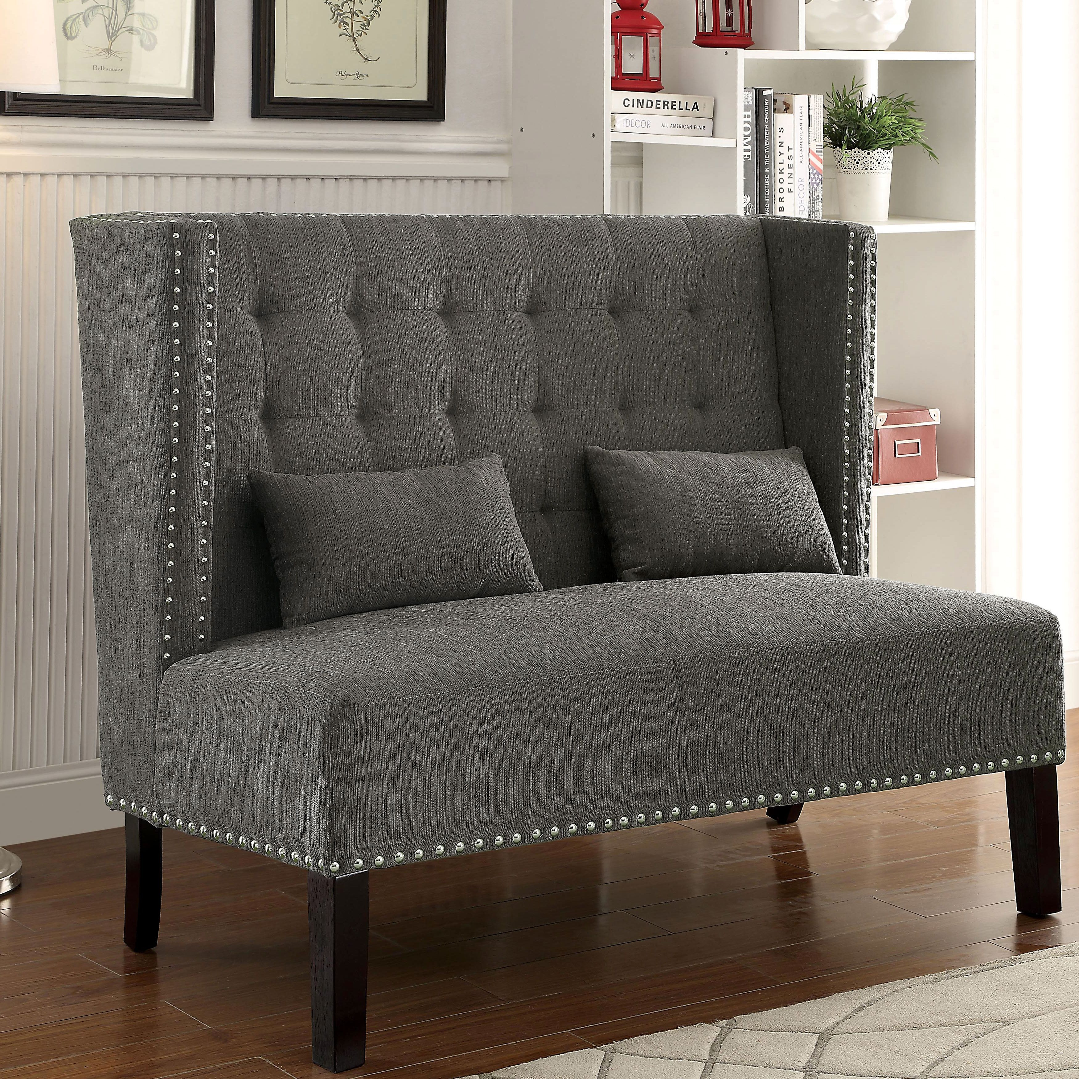 Gorgeously glam this romantic wingback loveseat features button
