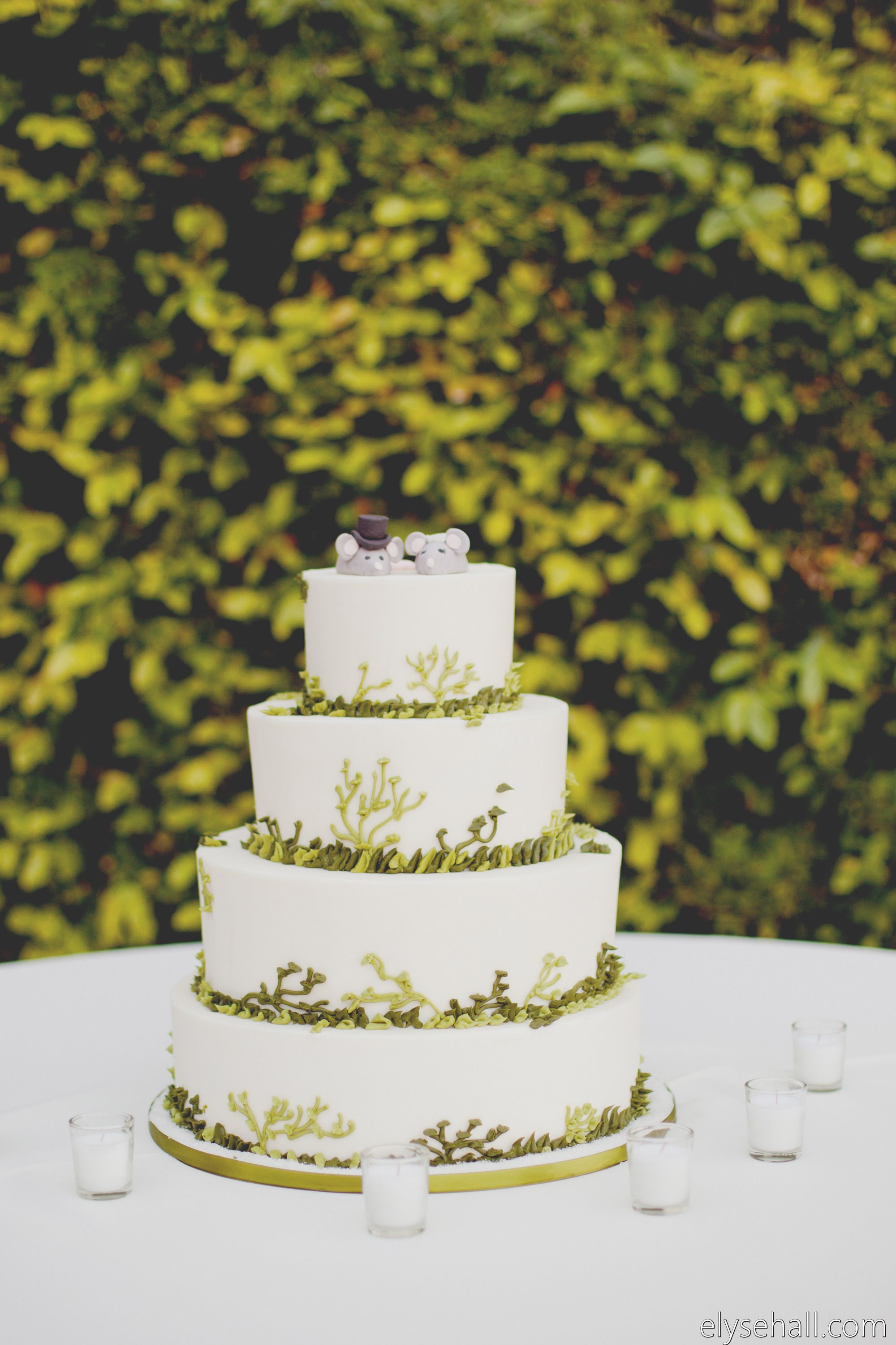 Woodland wedding cake with mouse topper!  Photography: Elyse Hall - www.elysehall.com  Read More: http://www.stylemepretty.com/southwest-weddings/2014/04/21/green-superstition-mountain-golf-and-country-club-wedding/