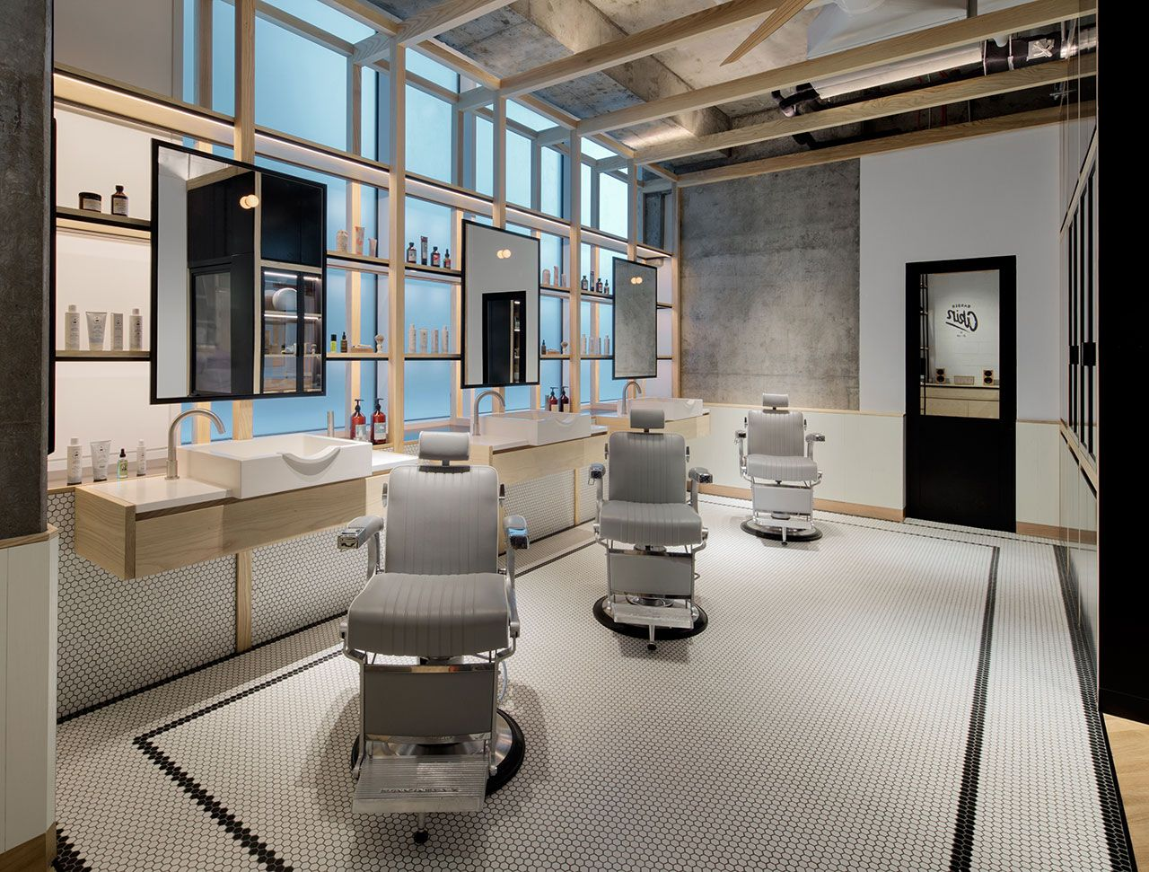 clean cut minimalism and tradition at akin barber shop in dubai - Barbershop Design Ideas