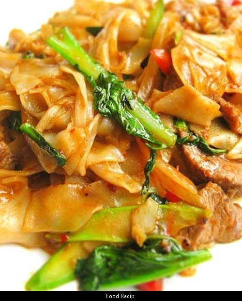 Recipe for Thai Drunken Noodles - There isnt a drop of alcohol in this dish  the name refers to how much youll want to drink to combat the heat. We suggest a nice cold beer or sparkling wine. | See more about Thai Drunken Noodles Drunken Noodles and Noodles.