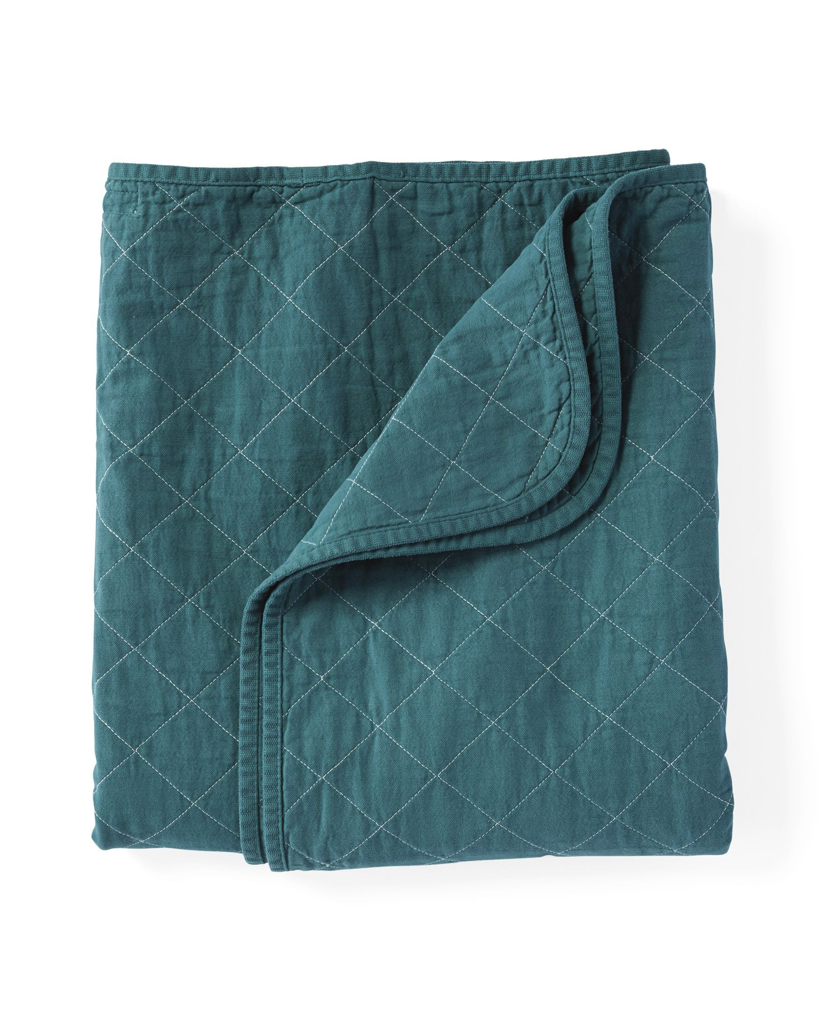 We've long admired Utility Canvas for their simple, versatile designs that don't fall short on style. This is no exception. Quilted of cotton canvas, it's super soft and durable. Plus, it's garment-dyed, so the colors are especially vibrant. Keep it at the foot of the bed or take it outside on chilly nights – it's made to be cherished indoors and out.