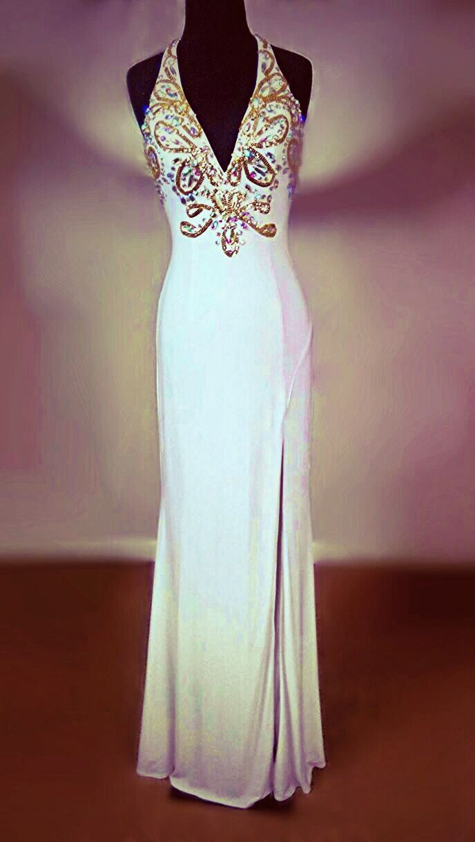 Jovani prom 2014 - Showcase your sophisticated taste in this classy-yet-seductive white matte-jersey halter gown from Jovani, available at Regiss as part of our prom 2014 offerings. Request Regiss style number 14457!