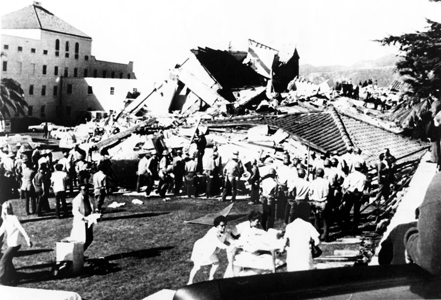 Rescue workers begin grim search for victims after a devastating earthquake destroyed two wings of the San Fernando Valley Veterans Administration hospital on February 9, 1971. San Fernando, Rey de España. San Fernando Valley History Digital Library.