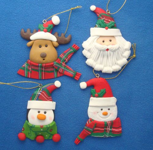 lot of 4 clay dough Christmas ornaments Santa Reindeer penguin snowman heads