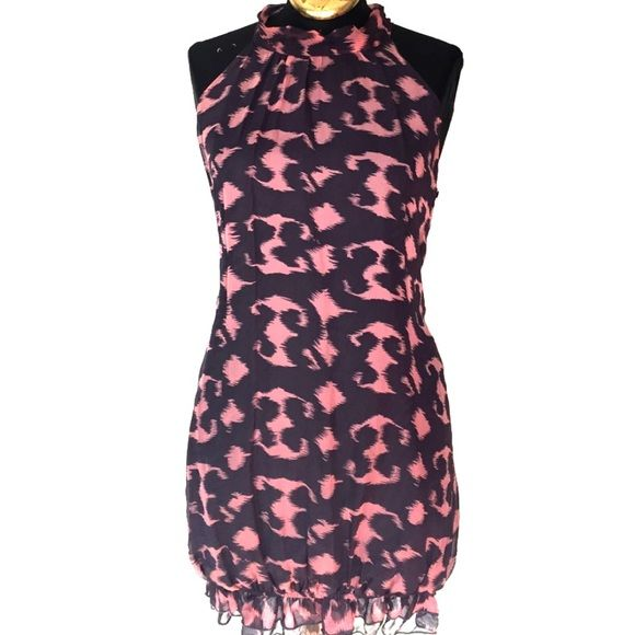Cute Dress In good condition no tears or rips.  It has a cute ruffle with loose elastic at the bottom for easy movement and cuteness.  Super cute dress to wear with heels or flats.  Love it with nylons or leggings for that chic look! Skyla Dresses Mini