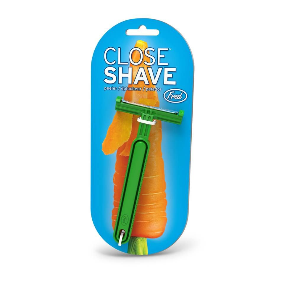 Funny grab shaped multi purpose fruits vegetable peeler bottle opener - Keep Your Vegetables Clean Shaven With The Close Shave Vegetable Peeler From Fred