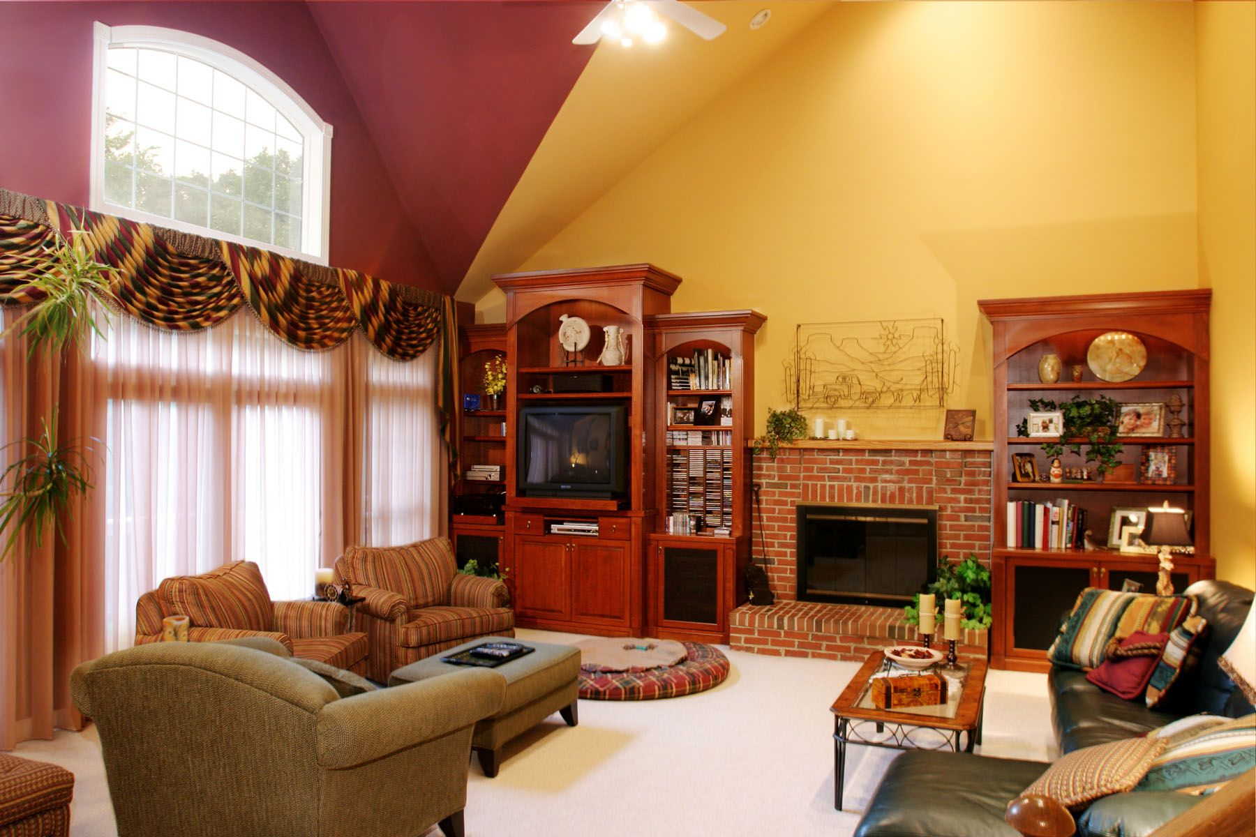 Living Room Appealing Yellow Wall Colors Panels Also Awesome Curio Cabinet And Comfortable Grey Sofas And Rustic Fireplace In Family Room Decorating Ideas