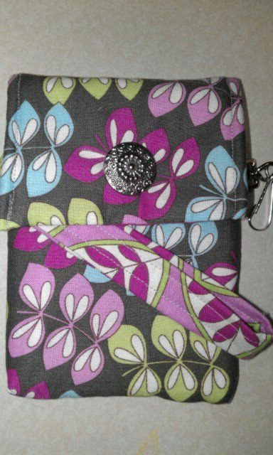 mini wristlet; No more phone bulge in your pocket. Mini-wristlet!!! Take anywhere!!! fits phones, money, debit card, lip gloss and a clip for keys!! Awesome!