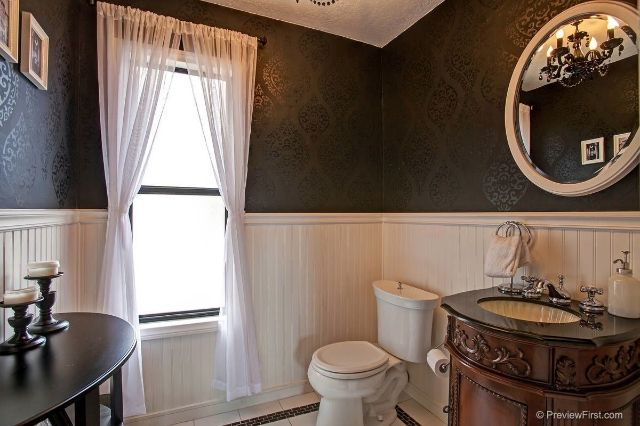 This Townhome For Sale In Bay Park Has A Very Elegant Design For The Half Bathroom Townhouse Bay Park Round Mirror Bathroom