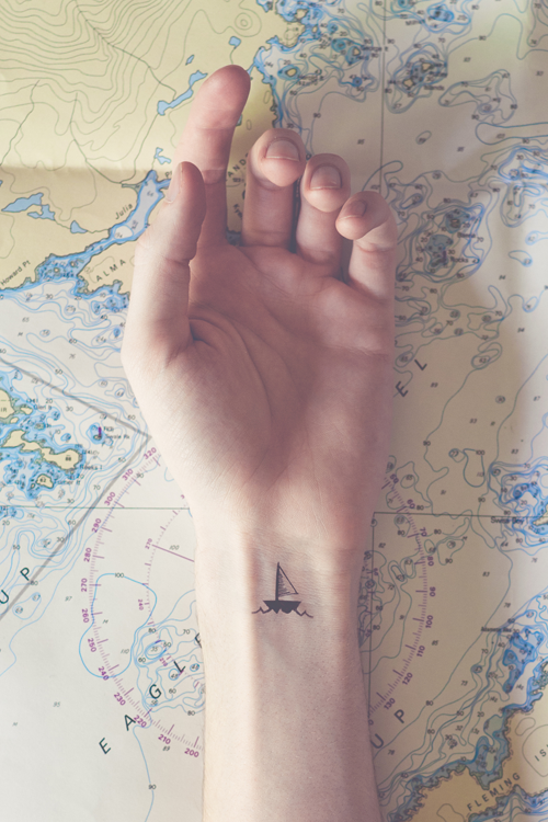 Sailboat Tattoo With The Word Wanderlust As The Waves Looks I