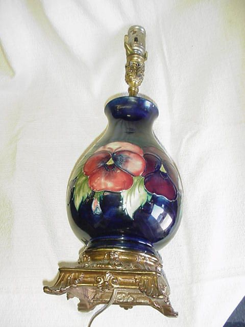 Rare moorcroft pottery table lamp in ovoid form with blue ground and rare moorcroft pottery table lamp in ovoid form with blue ground and pansy design having ornate gilted metal fittings impressed factory marks and hand aloadofball Choice Image