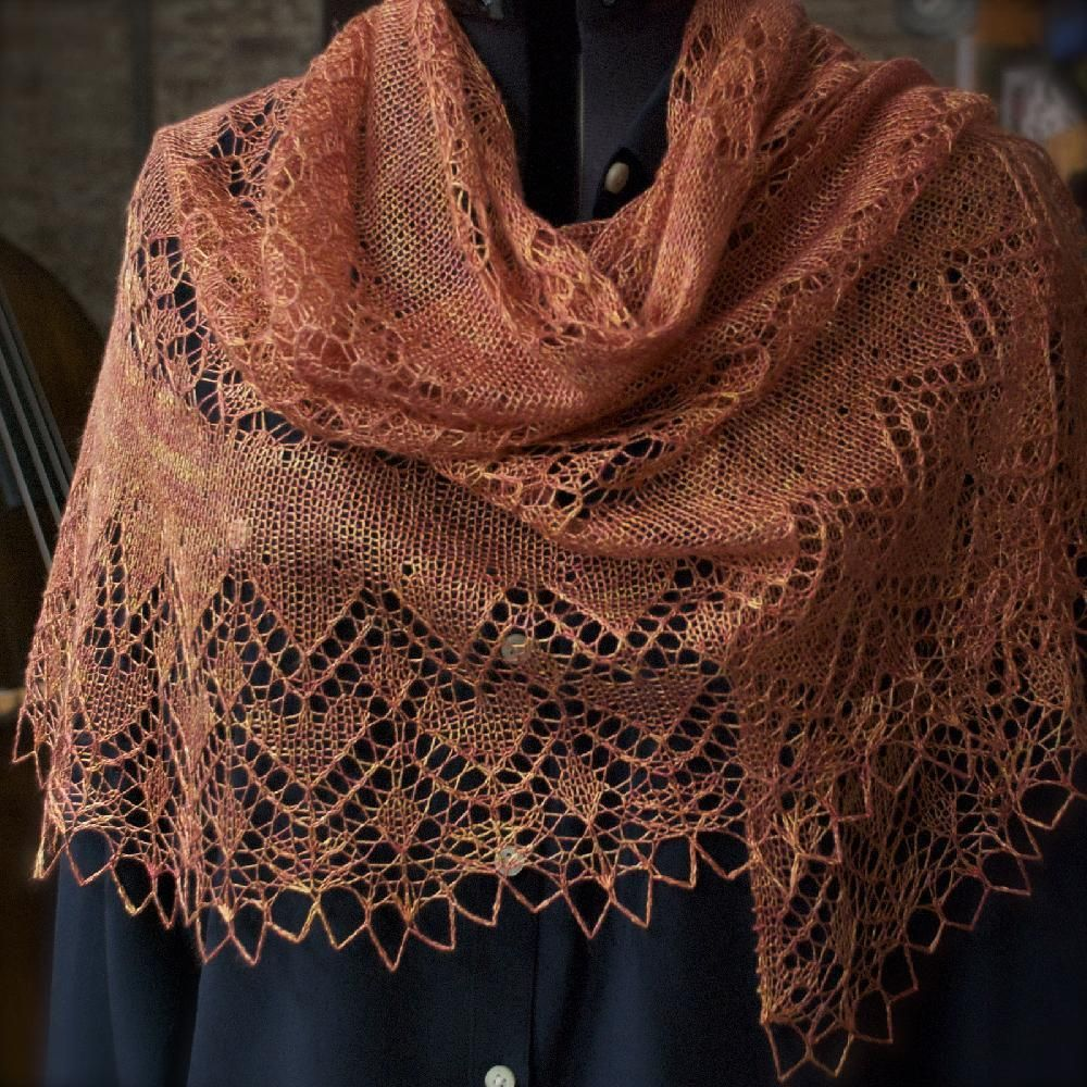 "This half pi shawl, designed using Sundara Yarns Silk Lace yarn in the ""Joy"" colorway, starts at the center top and and increases downward and outward to the bottom edge.Both charts and written instructions are given for the stitch patterns."