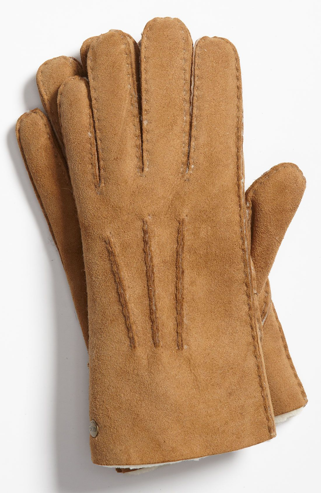 Keeping him toasty warm with Ugg Australia gloves.  3659446d66c