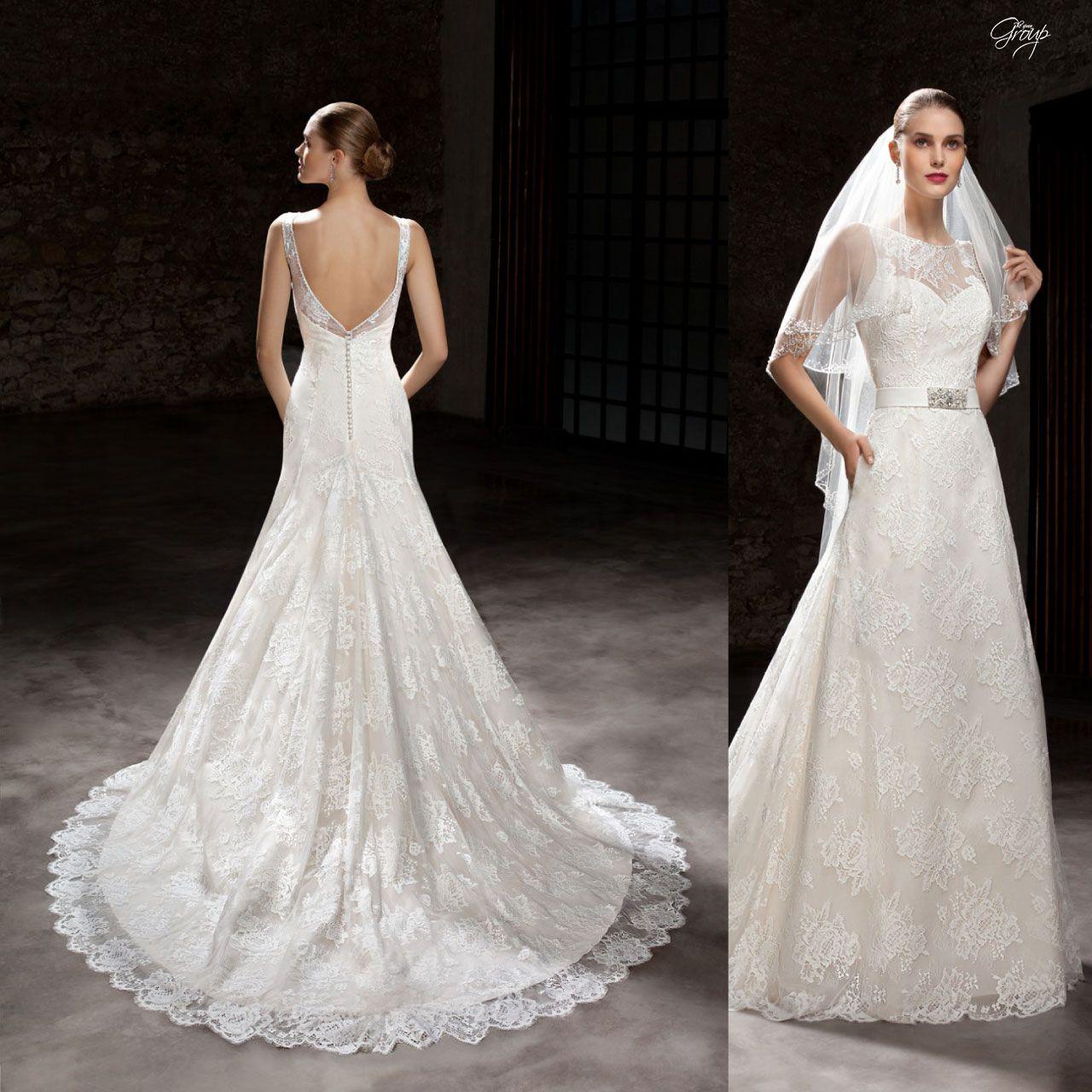 a6a97c49d48e Abito da sposa con velo e ricami in pizzo con ampia coda articolo 7867 The  Sposa