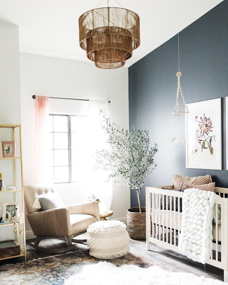 Bright Gender Neutral Nursery With A Dark Accent Wall And Boho Style