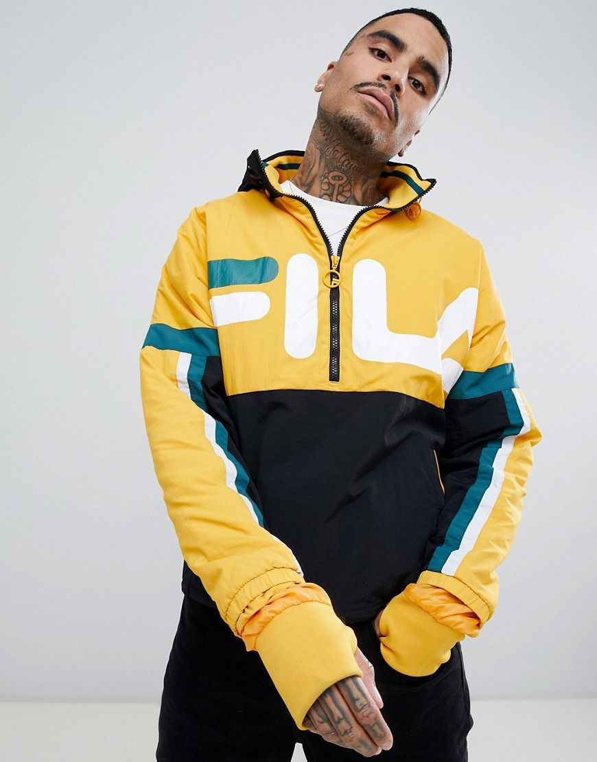 896ea841c4 FILA BLACK LINE RIKER OVERHEAD TRACK JACKET WITH LARGE LOGO IN YELLOW -  YELLOW. #fila #cloth