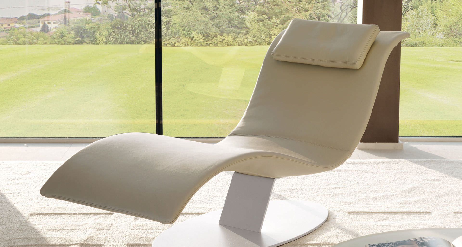 Cream Contemporary Floating Chaise Lounge Featuring Curve Shaped And  Rectangular Cushion Together White Metal Base
