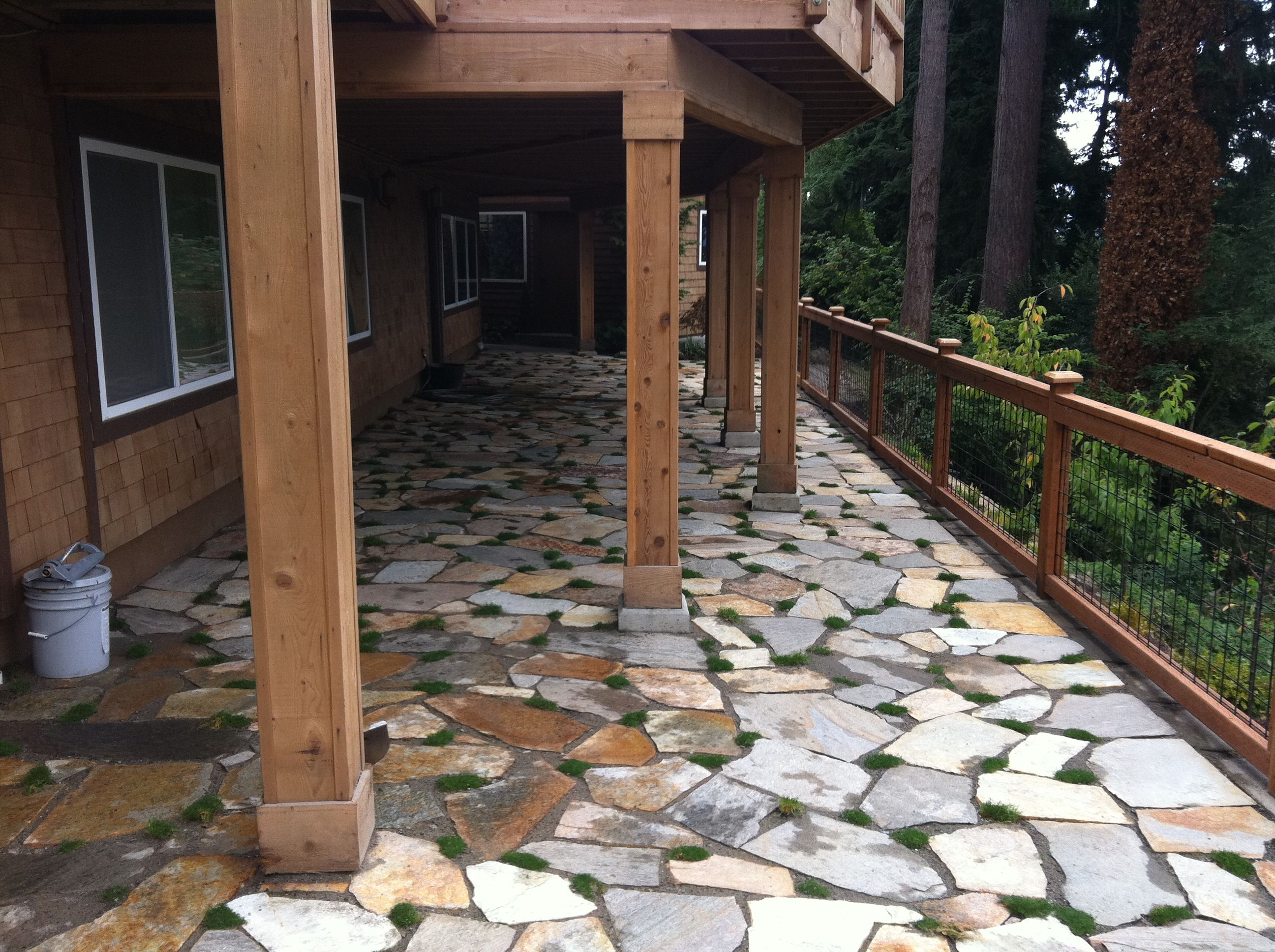 beautiful landscape design flag stone patio and moss installation