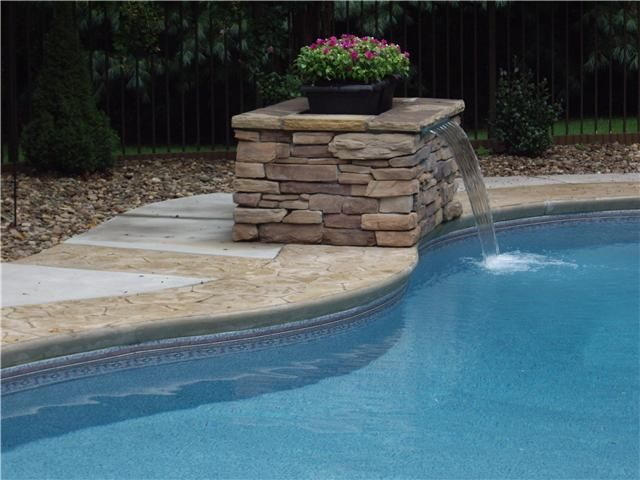 Pool waterfall yard deco pinterest pool waterfall backyard and swimming pools for Swimming pool fountains waterfalls
