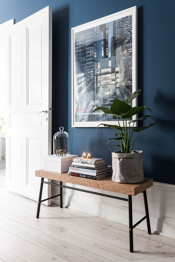 Dark Blue Walls, Light Floors, Cork Bench With Black Legs From Ikea, Plant,  Books, Artwork. ENTRY WAY Vignette Styling.