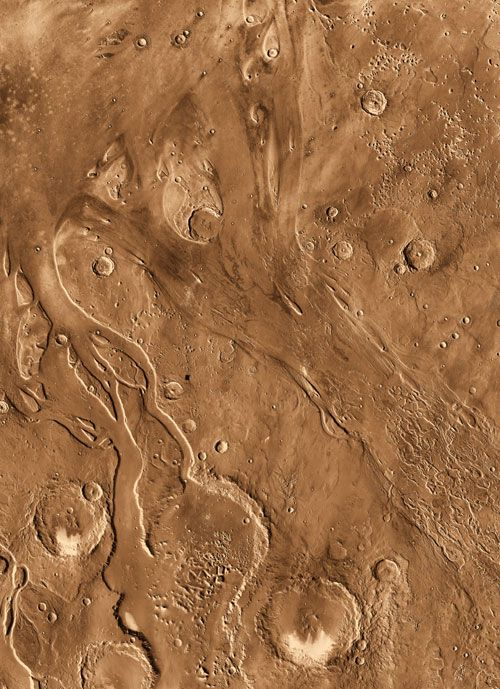 Channels scoured by ancient outbursts of flood waters are seen in this orbital view from Odyssey's Thermal Emission Imaging System.The channels are billions of years old and have likely been affected by multiple processes over time. Here, two channels, Tiu Vallis on the left and Ares Vallis on the right, flow northward from the highlands of the southern hemisphere of Mars.   NASA, JPL