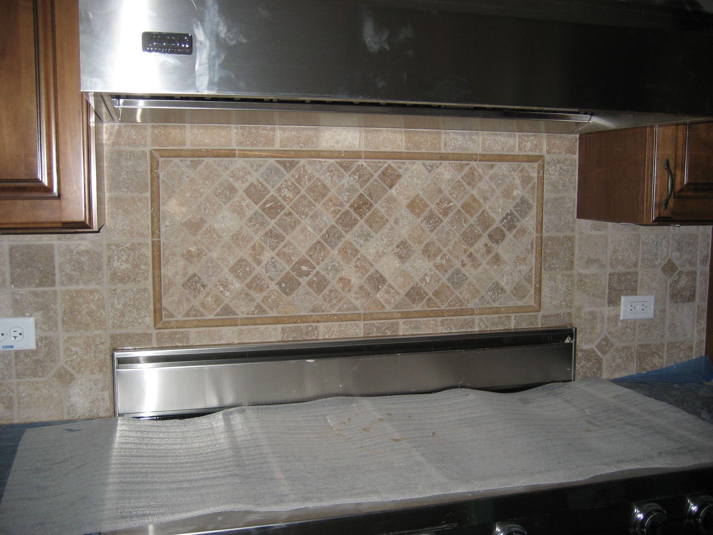 - Custom Tile Backsplash Inlay Behind Range. Custom Tile