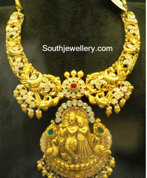 Antique gold peacock nakshi haram with radha krishna pendant photo antique gold peacock nakshi haram with radha krishna pendant photo aloadofball Images