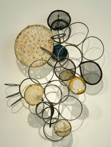 """by Rickie Wolfe  metal, paper, fibers, wax, and shellac 2010 - 20""""H x 12""""W"""