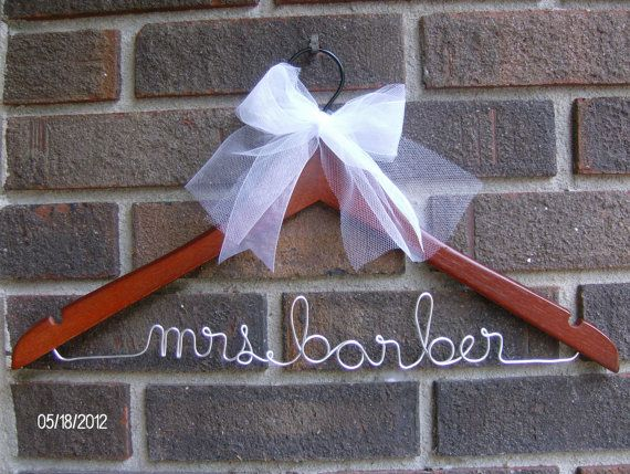 Personalized Hanger-Custom Bridal Hangers-Bridesmaids Gift-Wedding Hangers with Names-Custom Made Hangers- Cherry or Maple. $13.50, via Etsy.