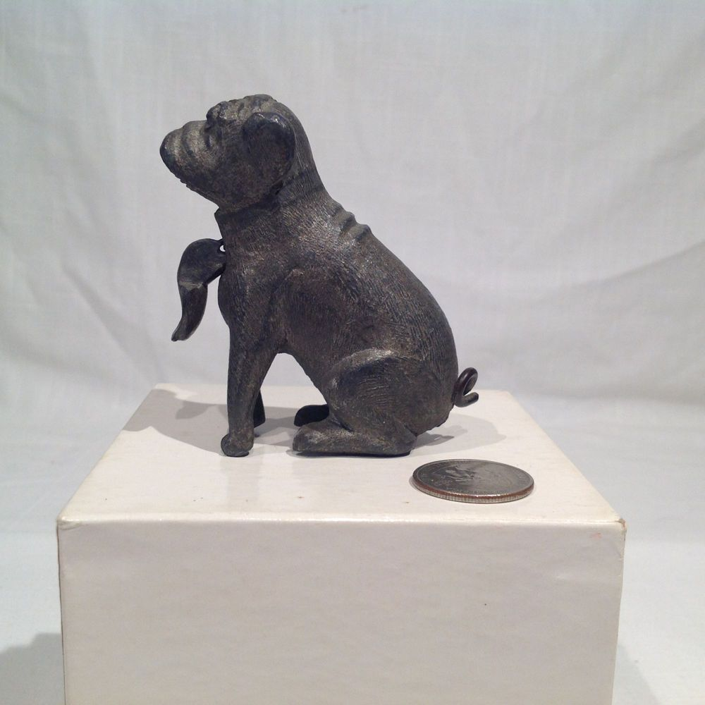 Antique figural lead bulldog with movable jaw which hangs