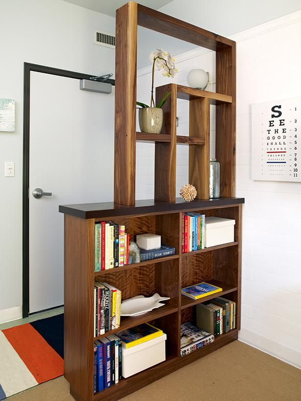 Such A Simple Practical And Stylish Solution For A Common Problem The Entry Door That Open Bookshelf Room Divider Living Room Divider Creating An Entryway