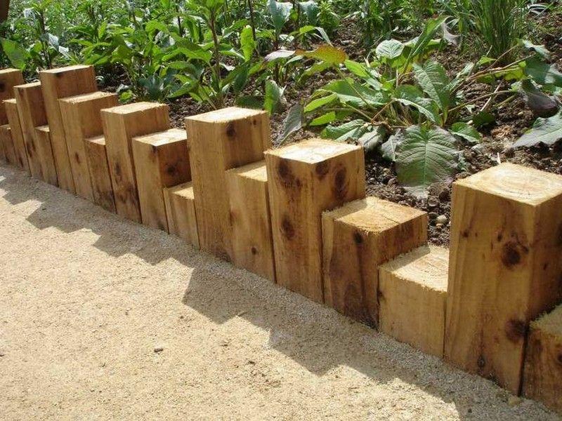 Eleven interesting garden bed edging ideas | Wooden garden edging, Wood garden edging, Timber garden edging