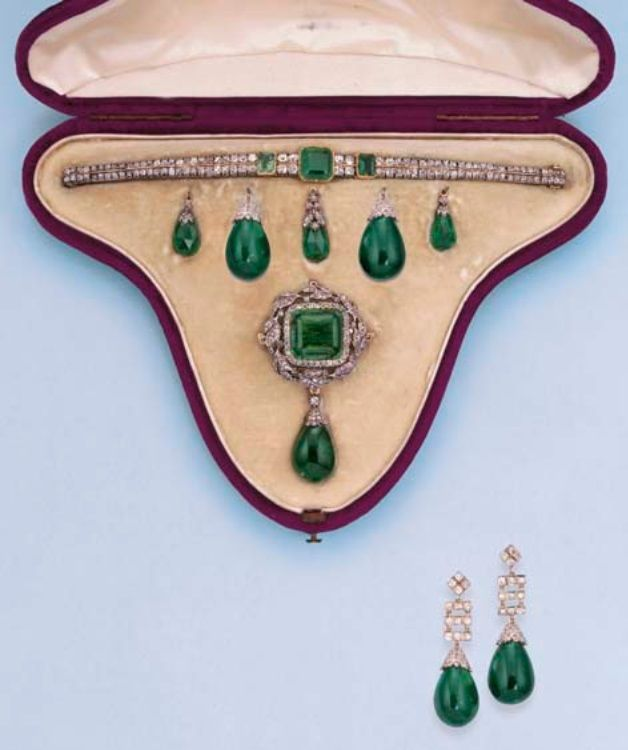 AN ANTIQUE EMERALD AND DIAMOND DEMI-PARURE. Comprising a brooch with six interchangeable diamond capped emerald drops, two of which have later been converted to earrings, and an emerald and diamond bracelet en suite, mounted in silver and gold, circa 1860. #Victorian #antique #parure