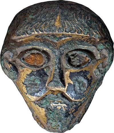 This well-groomed Irish man mask with inlaid amber eyes was later recast into a weight. It has been dated to the eighth century. (Photo: Thisted Museum)