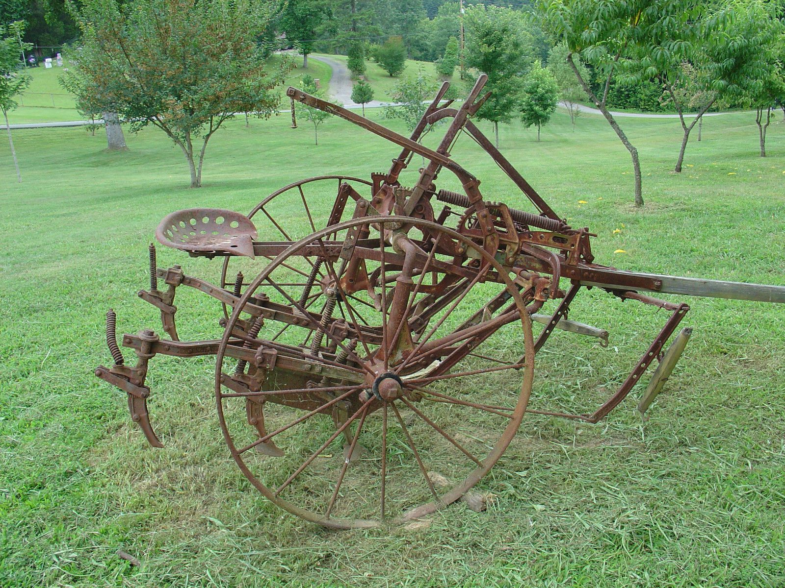 Antique farm equipment horse drawn riding cultivator / plow
