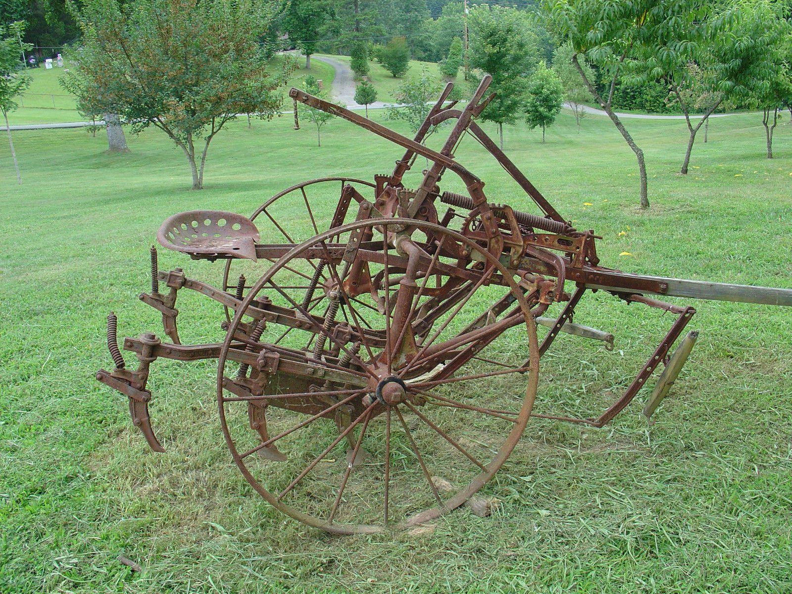 Antique farm equipment horse drawn riding cultivator