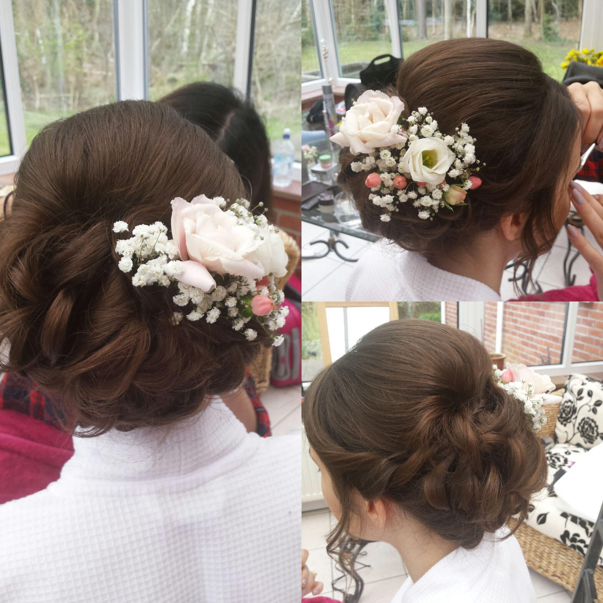 elegant brunette updo. fresh flowers in wedding hair. hair
