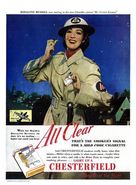"""Rosalind Russell blows the """"all clear"""" in this ad for Chesterfield cigarettes, published in the October 1943 issue of The American Home magazine. #vintage #1940s #WW2 #actresses #ads"""