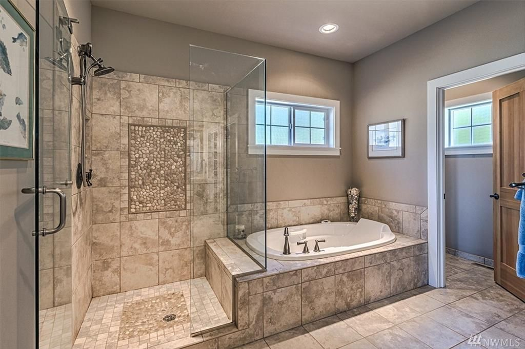 Gorgeous master bath extra large walkin shower glass door jetted tub and radiant heated