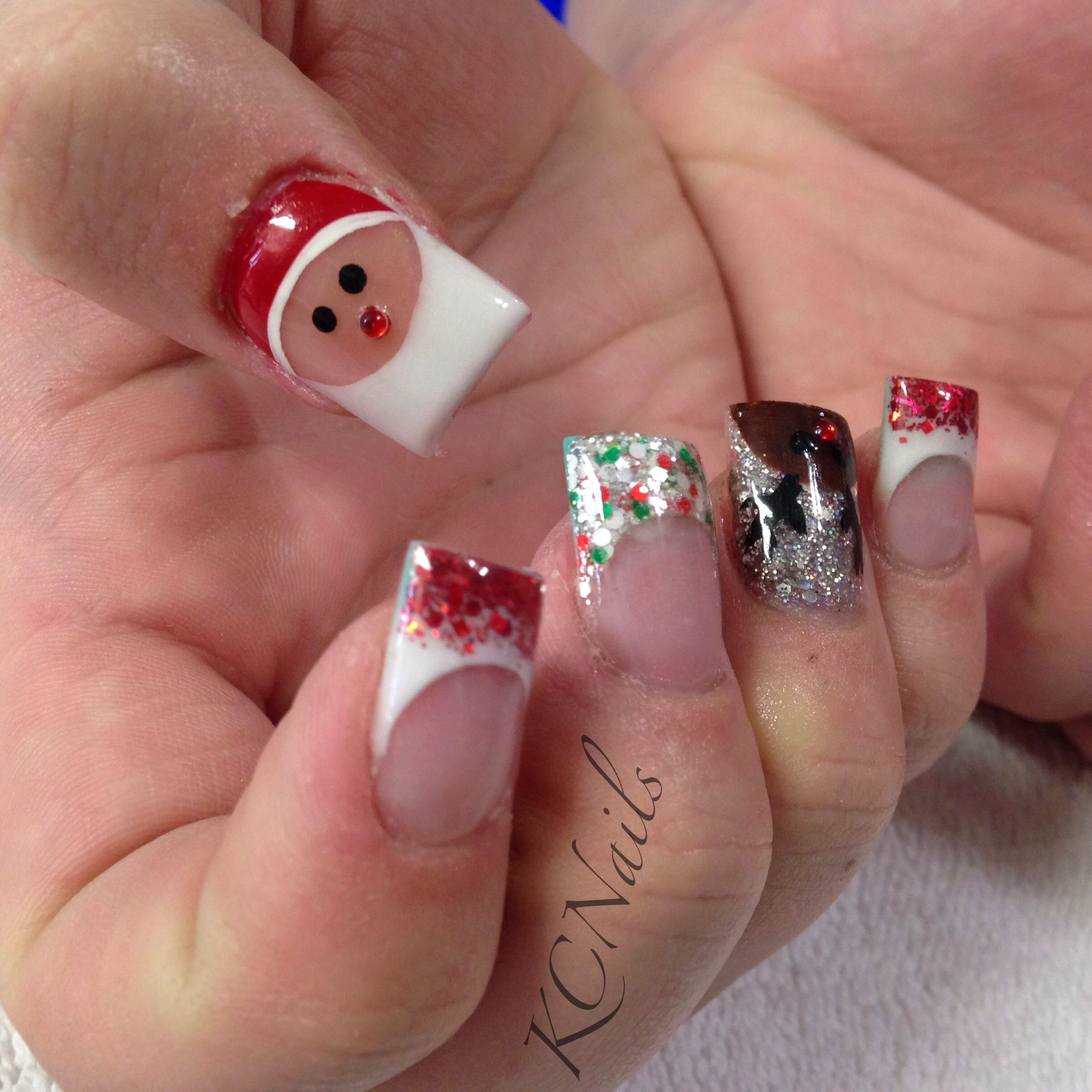 Christmas Nails Santa And Reindeer Hand Painted Nail Art Pink And White Acrylic Nails With A Red And Green Gli Xmas Nails White Acrylic Nails Christmas Nails