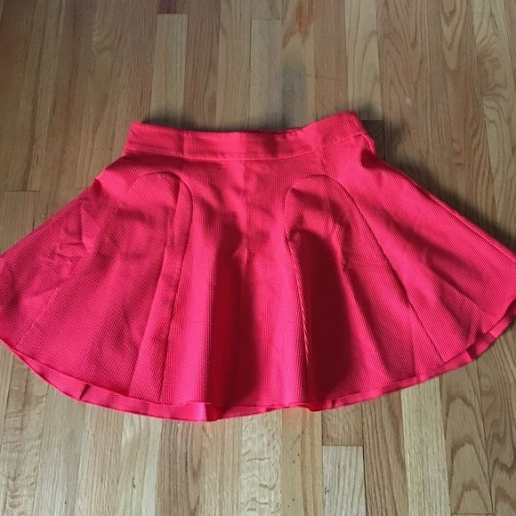 H&M coral mini skirt Mini flowy coral skirt only worn once without rips or tears. Is zip up with a button in the rear H&M Skirts Mini