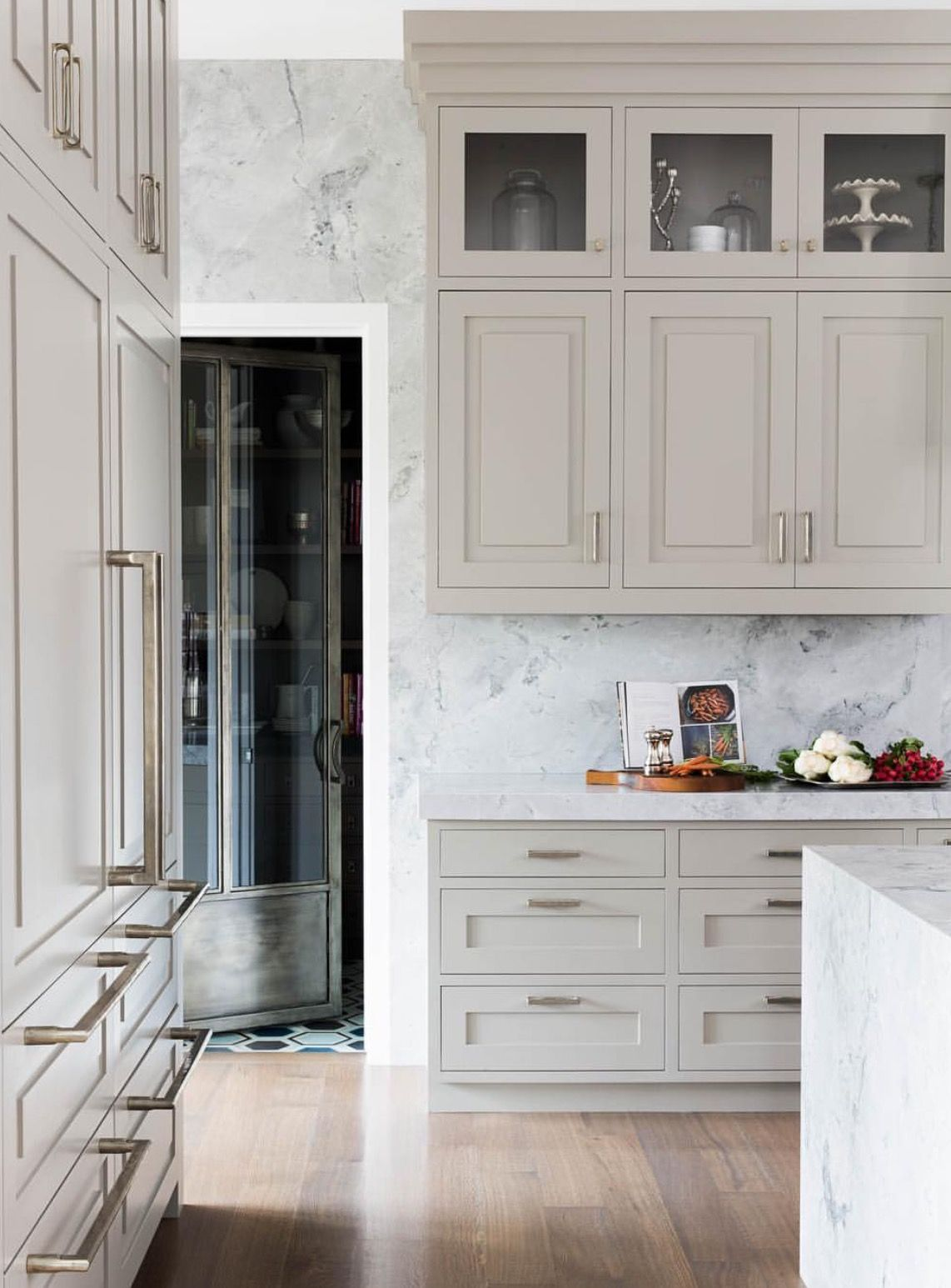A glass and metal pantry door is