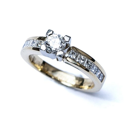 Diamond Solitaire With Channel Set Shoulders