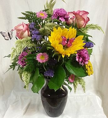 Lively Erflies Prance About Delightfully In This Truly Original Arrangement Created By Fl Designer Jessica Of Prevatte Florist And Gifts