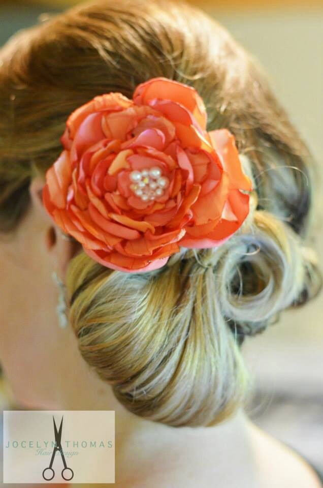 Bride long hair updo with flower.