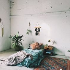 A Minimal Room Mattress On The Floor Or Small Wooden Frame Plants