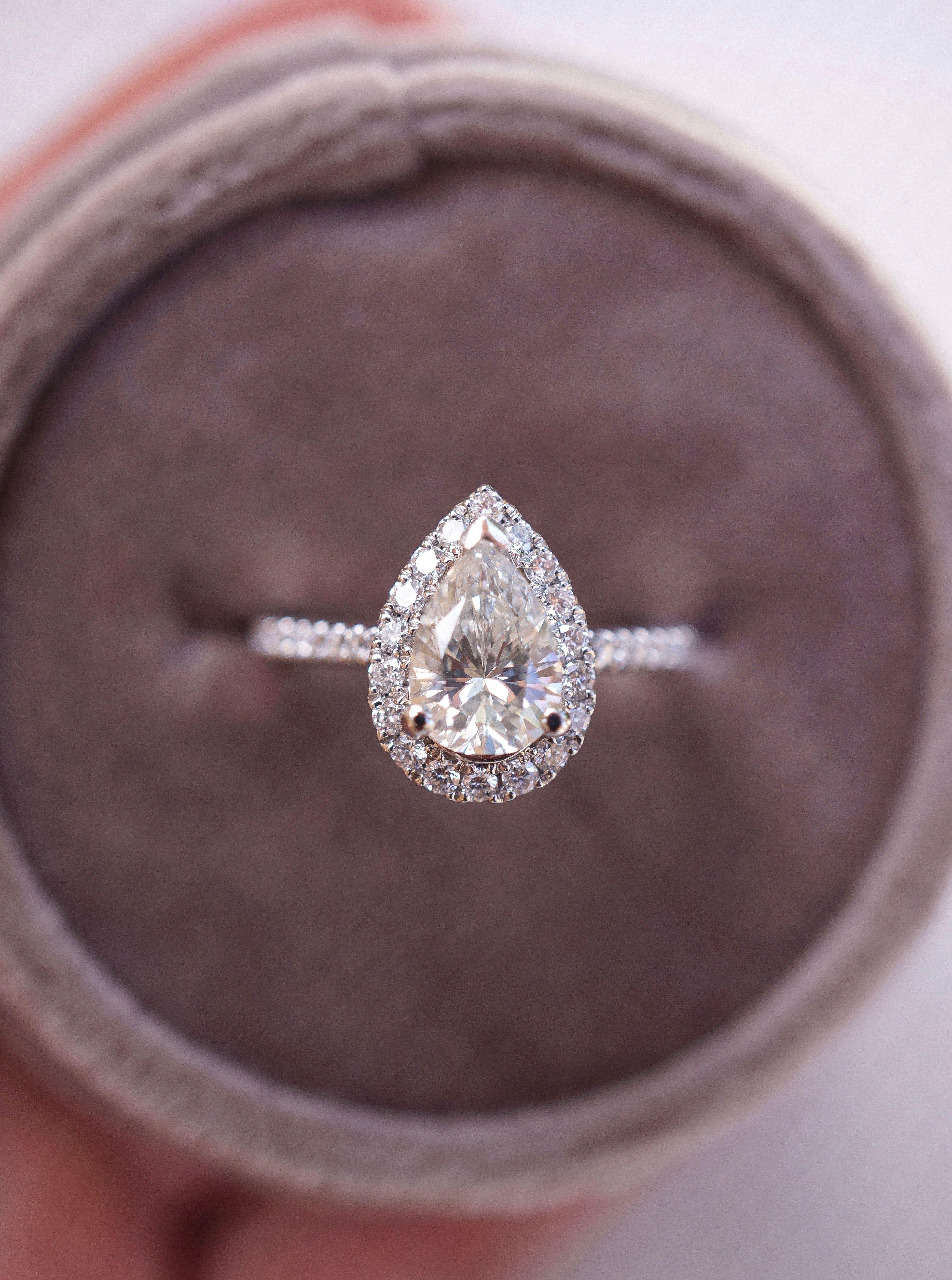 Pear shape diamond halo engagement ring in platinum setting gia